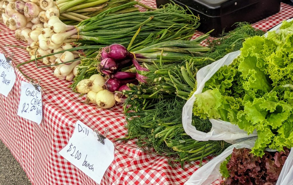 Farmers Market table with fresh vegetables