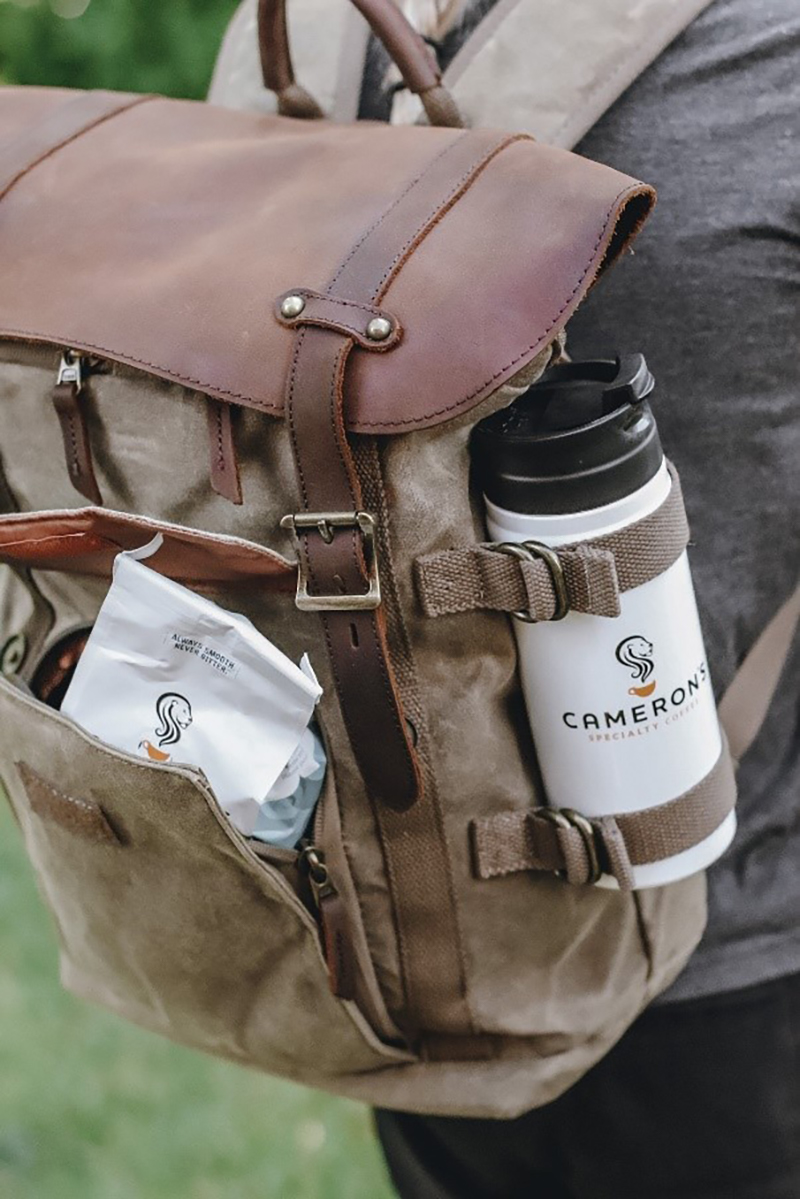 Cameron's Coffee bag and tumbler in backpack